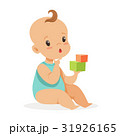 Sweet little baby sitting and playing with cubes 31926165