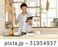 キッチン 男性 料理の写真 31954937
