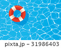 Red pool ring floating in a blue swimming pool. 31986403