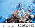 Message in a glass bottle on a pile of pebbles and 32058443