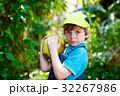 Happy funny little preschool kid boy holding huge 32267986