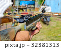 Man aims at target by crossbow or arbalest. 32381313