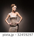Young woman in an evening dress and jewels 32459297