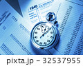 Tax form, operating budget and stopwatch 32537955