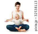 Young mother sitting with her child 32538113