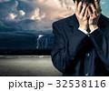 Businessman in despair on stormy sky 32538116