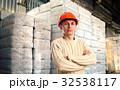 Workman in red helmet 32538117