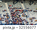 blurred crowd of people in a stadium 32556077