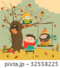 Happy kids ride on a swing in the autumn forest 32558225