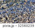 Stones under sea water 32560239