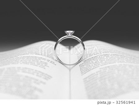 Wedding ring on the book page. 32561941