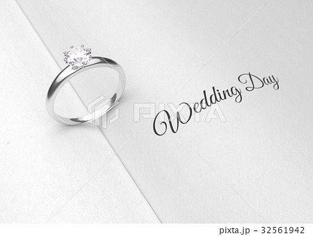 Wedding ring on the book page. 32561942