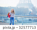 Young girl with shopping bags near the Eiffel tower 32577713