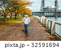 Man walking along the riverwalk in Portland city at autumn 32591694
