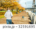 Man walking along the riverwalk in Portland city at autumn 32591695