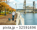 Man walking along the riverwalk in Portland city at autumn 32591696