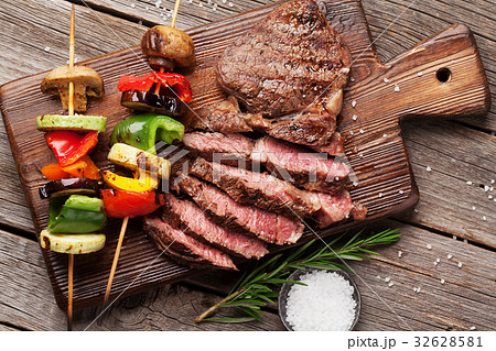 Beef steak and grilled vegetables on cutting board 32628581