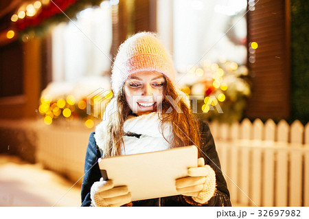 Young woman using tablet computer on the street 32697982