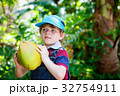 Happy funny little preschool kid boy holding huge 32754911