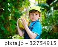 Happy funny little preschool kid boy holding huge 32754915