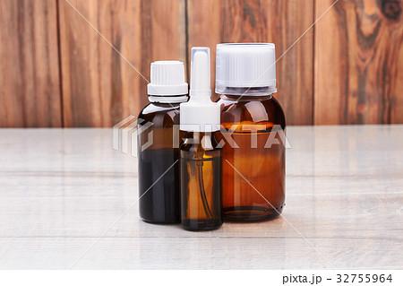 Remedy vials on wooden surface.の写真素材 [32755964] - PIXTA
