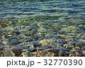 Stones under sea water 32770390