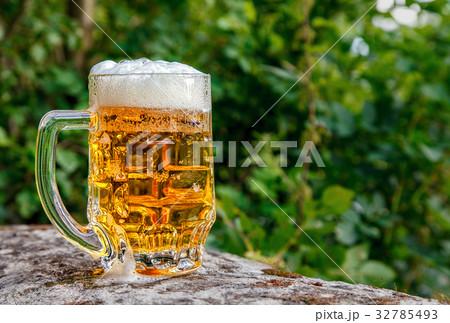 glass mug with beer standing on the big stone 32785493