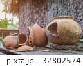 Broken antique clay pot or traditional Jar  32802574