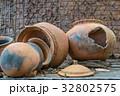 Broken antique clay pot or traditional Jar  32802575