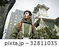 人物 男性 時計台の写真 32811035