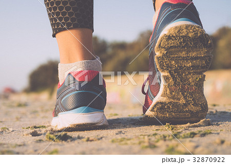 Woman in sneakers walking on the beachの写真素材 [32870922] - PIXTA
