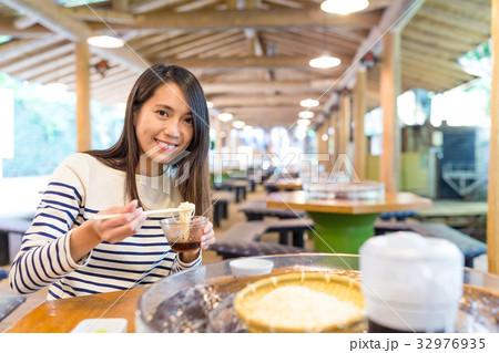 Woman having famous japanese somen in restaurant 32976935