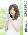 女性 スマートフォン スマホの写真 32983609