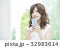 女性 スマートフォン スマホの写真 32983614