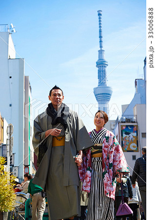happy couple in kimono is holding hands and walking together 33006888