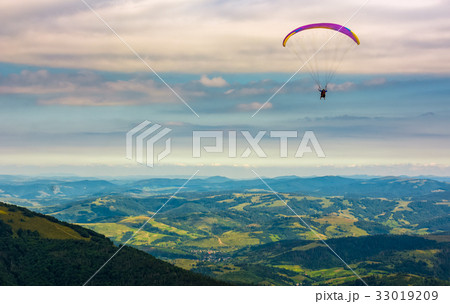 Skydiving  extreme over the rural valley 33019209