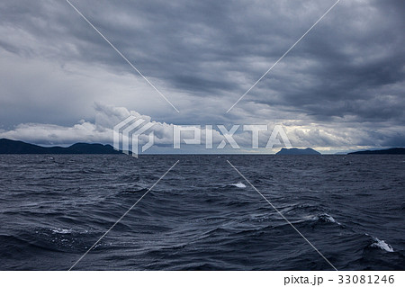 A stormy sea with dark clouds and Islands 33081246