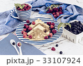 pancakes with raspberry, currant on blue plate 33107924