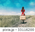 young woman with suitcase 33116200