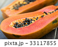 Slices of fresh cutted papaya 33117855