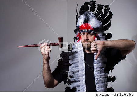 man with pipe in his hand shows smoking is badの写真素材 33126266