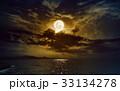 Rising yellow full moon in dark night sky  33134278