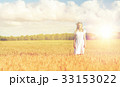 happy young woman in flower wreath on cereal field 33153022