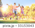 happy teenage couple jumping at summer park 33153043