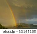 夕陽に照らされる虹と島 33165165