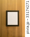 blank brown photo Frame wooden wall. Background  33174271