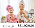 woman and girl with mustache on sticks 33192989
