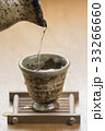 Close-up Pouring sake The Japanese eating culture on wooden tabl 33266660