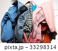 man holding pile of clothes 33298314