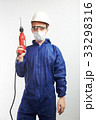 Worker holding drill 33298316